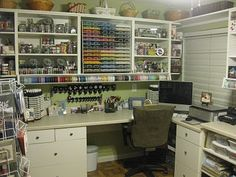 View of my desk area with paper and ribbon storage and shelving for embellishments above. My punches hang on the wall for easy access and my inks are within easy reach as well. Computer access too! :-)