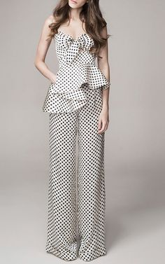 This dot printed **Johanna Ortiz** pant is rendered in silk charmeuse and features a fluid wide leg with an asymmetrical peplum detail.
