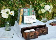 I adore this book themed wedding!  Guests search the card catalog for their placecard, table names, bookmarks and favors all are book themed.  Wonderful.