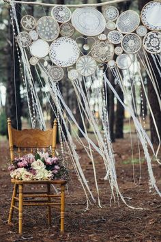 33 Boho Wedding Arches, Altars And Backdrops To Rock: crochet dreamcatcher wedding backdrop with ribbons