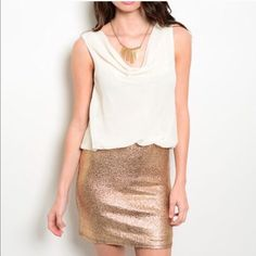 Golden Shimmer Dress Embellished Shimmery gold skirt with a white flowy chiffon top. Wear to any special event! Dresses