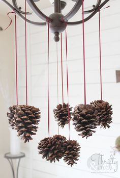 Hang pine cones from light/chandelier for cute Christmas decor.