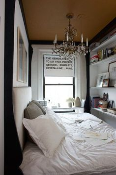 """Go big in small spaces for a surprising, luxurious feeling. This tiny bedroom is just big enough for one complete four poster bed and a chandelier, so the owner built it all in. When a space is too small to fit everything you want in in a traditional way, consider reducing the pieces and making them bigger to fill the room wall to wall."" Photo: Courtesy of Apartment Therapy"