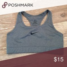 Sports bra Gray Nike sports bra with black check in middle, great condition Nike Intimates & Sleepwear Bras