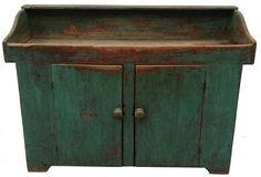 """Early 19th century Pennsylvania , Drysink with the beautiful teal  paint over original red. Two baton doors with bread board ends on top and bottom. The shelf is double  mortised thought the sides. with open well it has graceful waterfall cut design on ends, with a back shelf. The sides  of the drysink has a cut out feet.  circa 1820   measurements are:53"""" wide x 19 1/2"""" deep x 37 1/2"""" tall"""