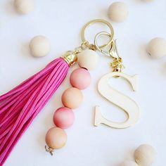 The 11 Best DIY Keychains From stamped leather to dyed wood beads, tap into your crafty side with on Diy Crafts Keychain, Cute Keychain, Tassel Keychain, Leather Keychain, Bead Keychain, Keychain Ideas, Handmade Keychains, Diy Jewelry To Sell, Jewelry Making