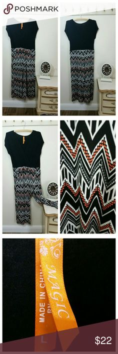 Jumpsuit, Short Sleeves, zig zag print, by Magic Fun and colorful Jumpsuit Solid black top Colorful zig zag print Black, orange, turquoise Wide leg Stretch fabric  Label:  Magic,  size large.  12/14  Worn once  Excellent Condition Magic Dresses