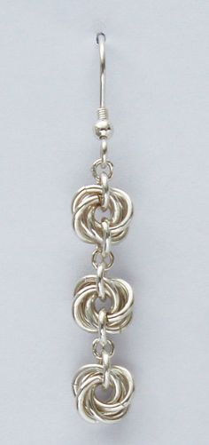 Beautiful sterling silver chainmaille drop earrings with a floral motif of three mobius rosettes. Lightweight and elegant, these beautiful silver