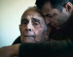 father/son a truly heartwarming photo of love and compassion.