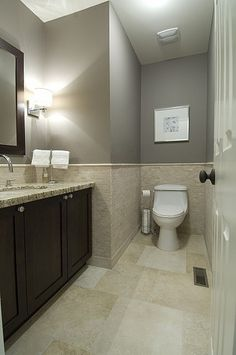 Gray Bathroom- maybe a shade or two lighter? Also love the lighting on sides of the mirrors.