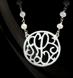 Large 1-5/8″ single initial circle lace pendant adorned with pearl chain or black spinel by Jane Basch