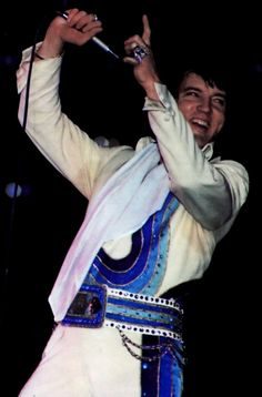 ELVIS ON STAGE IN THE BLUE SWIRL JUMPSUIT IN 1974