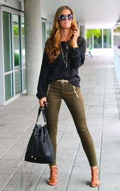 Love the olive and black and the zipper details on the jeans .