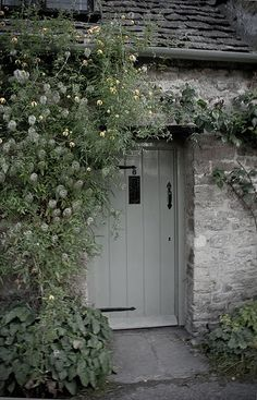 door Small Soft shades of gray repeated in the cottage colors and . the flowers clamoring up the doorway.Soft shades of gray repeated in the cottage colors and . the flowers clamoring up the doorway.