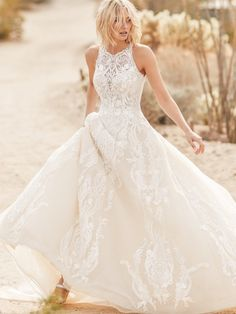 25545 - Tovah - Whoever says princesses have no place on the beach we simply will not tolerate. Presenting this halter ball gown wedding dress for easy-breezy-regal vibes.  Try this beauty on at Aurora Bridal in Melbourne, FL 321-254-3880