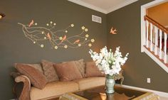 Interior wall with bird & branches mural motif and floral blossom