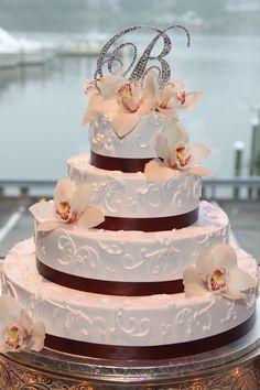 Monogram on top of wedding cake