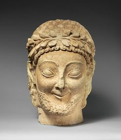 Limestone male head, late 6th century B.C. Greek. The Metropolitan Museum of Art, New York. The Cesnola Collection, Purchased by subscription, 1874–76 (74.51.2836)
