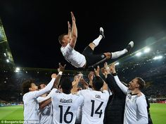 March 22nd. 2017:Lukas Podolski is thrown in the air by his team mates after playing his last game for Germany, against England