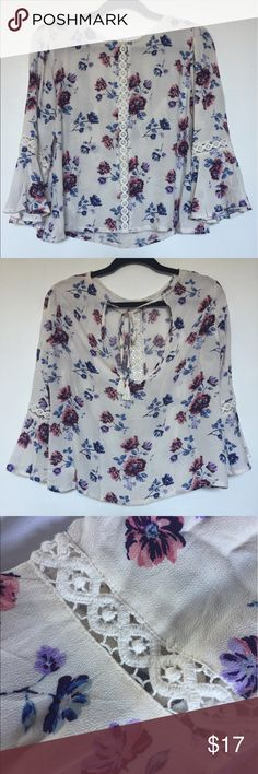 Bell Sleeve Peasant Top Very cute floral print top with crochet detailing down the middle of the shirt as well as around the sleeves. Bow with tassels on the back. Thank you for visiting my closet. Please feel free to ask any questions. Forever 21 Tops Blouses