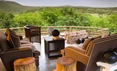 Phinda Mountain Lodge lies nestled next to the Ubombo Mountains, warm and inviting in the midst of the South African bushveld. This luxury lodge is immediately gorgeous in its appointment, the dramatic vista of the Phinda reserve stretched out before it Game Reserve South Africa, South Africa Tours, Wetland Park, Private Games, African Safari, African Animals, Africa Travel, Lodges, Outdoor Furniture Sets