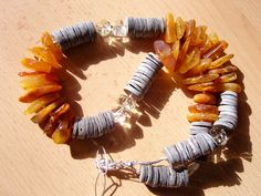 Baltic amber, grey shell, yellow quartz