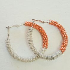 Beaded hoop fashion earrings Beaded hoop fashion earrings  Color: silver and orange tone  Wide 2 inch  Condition: perfect condition No trades Jewelry Earrings