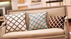 Glue the lace on in criss-cross pattern for great looking and affordable pillows!