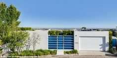 Not much to see from the outside: Thestunning 3,821 square feet residence is hidden behind high walls and its two-car garage