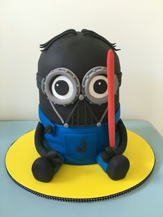 Darth Vader Minion cake 3-layers of dark chocolate cake filled with Baa-nana butter cream, covered in fondant.