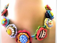 Dotty. A very cute crocheted flower with fabric-covered button centers.
