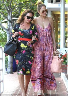 Star-studded: Leah Remini, Pitbull, Eva Longoria, Ryan Seacrest, newlyweds Cameron Diaz and Benji Madden, and Victoria and David Beckham, are among those who will watch her say 'I do' - seen above, J-Lo and Leah enjoyed an outing last year