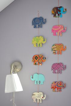 Easy wall decor with wooden shapes, paper & ModPodge. I wouldn't use Elephants but I could probably find something else in our theme.