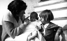 Throwback Thursday, John F. Kennedy Rose Kennedy, at left, enjoys a tender moment with two of her young children, a young JFK (center) with big brother Joe Jr. looking on. -from the JFK Library