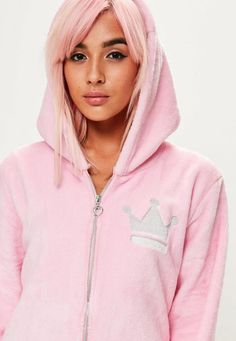 Pink fleece onsie with embroidered crown, hood and front zip fastening.