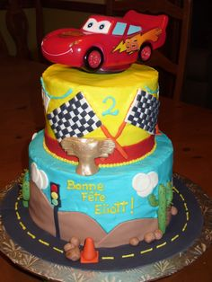 Flash McQueen cake  This was my son's 2 year old Cake.  The toping car is actually a bed light that we lighted up signing happy Birthday...   Wonderfull to see his face!!!!