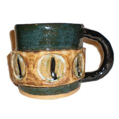 Ceramic Eye Coffee Cup With Ring of Cat Eyes by aberrantceramics