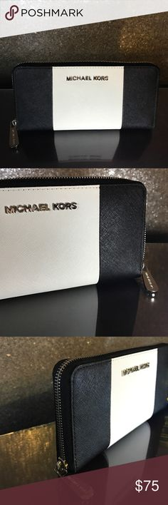 NWOT Michael Kors Two-toned Wallet *NWOT* Black and white two-toned saffiano leather wallet with silver toned hardware. I purchased this NEW from Michael Kors boutique in White Plains, NY. Never worn. Brand new condition. Interior features include: 1 center zip pocket, 12 card slots (6 on each side), 2 bill slots on each side. 'MICHAEL KORS' embossed on interior leather. All hardware in brand new condition. No scratches, tears or discoloration. MICHAEL Michael Kors Bags Wallets