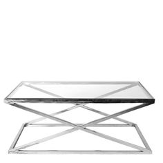 EICHHOLTZ COFFEE TABLE CRISS CROSS | Eichholtz Furniture - Interiors  Stainless steel - glass  A stunning contemporary designer coffee table, made from stainless steel base with a glass top. The sharp edges and symmetrical lines will add the modern look and drama to any living room. This coffee table with criss cross legs comes in different sizes.