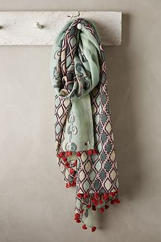 L'acquario Scarf #anthropologie I love the tassels off this scarf but it is a bit too pricey. Colors are also a nice contrast of burgundy with a range of greens.