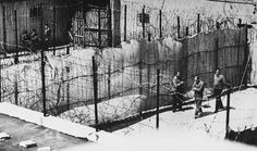 "Adolf Eichmann: ""Barbed wire his victims once knew now confined his walks."""