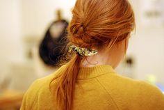 tie a braid with a scrap of cloth