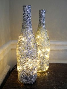 Sparkly coated wine bottle lights...cute decor for a windowsill at Christmas time with garland too.  Celebrate with Renaissance Fine Jewelry at www.vermont jewel.com, Facebook or at our 151 Main Street, Brattleboro, Vermont location. We love to make everyone happy!