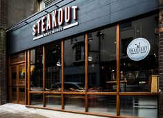 Design showcase: Steak Out restaurant ropes in customers with cow-themed references - Retail Design World Restaurant Exterior Design, Cafe Exterior, Design Exterior, Exterior Signage, Facade Design, Bungalow Exterior, Stucco Exterior, Modern Exterior, Exterior Paint