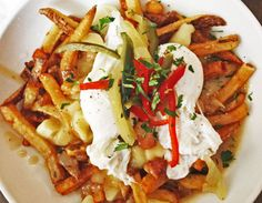 Poutine, Canada's popular late-night snack, has taken over Chicago. Try our favorites at Bite Cafe, Little Market Brasserie, The Gage and Boarding House.