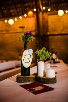 simple rustic centerpiece (although the wax from those pillars would make a mess! Burgundy Wedding Cake, Fall Wedding Cakes, Fall Wedding Flowers, Wedding Flower Arrangements, Wedding Favours Gin, Popcorn Wedding Favors, Rustic Wedding Centerpieces, Wedding Reception Decorations, Diy Centerpieces