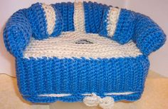 Great Decorative piece for the home! or Give as a Hostess Gift!  Handmade crochet sofa tissue box cover made in 100% acrylic.  Cover fits regular sized tissue box 4 3/4 deep by 3 1/2 high by 9 inches long. Color - Blue with Soft White (off white) Accents and drawstring  The back, arms and throw pillows (2) are stuffed with washable fiberfill (100% Hypo Allergenic Polyester).  Machine wash, cold, gentle cycle, tumble dry low temp per manufacturer label instruction or air dry. All Ite...