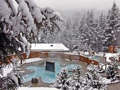 After a day on the slopes relax in a hot pool while watching the sun set over the Scandinave Spa - Whistler, British Colubia, Canada