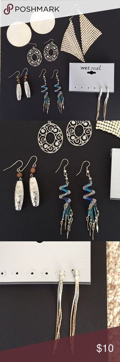 """🔴 Earrings (5pr) - To Be Donated Five pairs of silver-toned earrings, 4 with fish-hook and 1 with post style. Silver jeweled ovals with white and purple gems (1.5""""), silver barrels with wooden bead (1.5""""), Spirit of Nature spiral designs (2""""), Siamese cats (1""""), and jeweled dangles on post (2.5"""") - mild tarnishing along bottom of dangles. All others in excellent shape. This item will be donated on 1/13/2017 (Friday) if not purchased! Jewelry Earrings"""