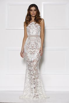 a beautiful full length lace evening gown by designer grace & hart. featuring varying textured lace, honeycomb mesh and super-fine voile.<br />back zip<br...